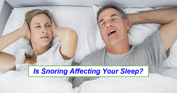 Wife covering her ears because she can't sleep next to snoring husband, with the words, Is snoring affecting your sleep?